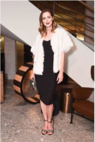Eva Amurri in Max Mara white shearling coat and black dress.