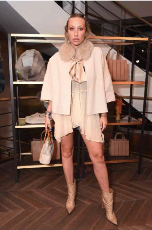 Gaia Matisse in Max Mara tan jacket.