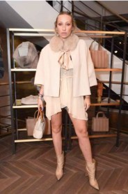 Gaia Matisse in Max Mara tan jacket.