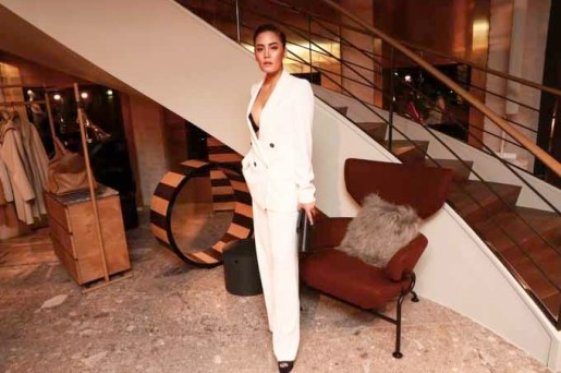 Janie Tienphosuwan In Max Mara white double-breasted suit.
