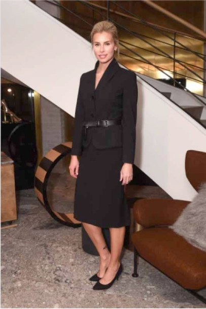 Niki Taylor In Max Mara black blazer, black pencil skirt, black belt.