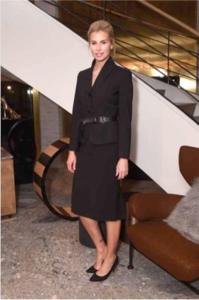 Niki Taylor In Max Mara black blazer, black pencil skirt, black belt.
