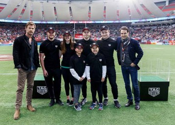 VANCOUVER, BC - MARCH 11: (TAG Heuer Ambassador Chris Hemsworth (L) and TAG Heuer President North America Kilian Muller (R) pose with local rugby players after TAG Heuer donates money to indigenous youth rugby programs at the 2018 Canada Sevens Rugby Tournament at BC Place on March 11, 2018 in Vancouver, Canada. (Photo by Andrew Chin/Getty Images for TAG Heuer)