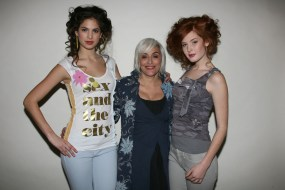 Natalie (middle) with models wearing some of the one-of-a-kind t-shirt designs