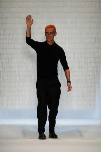 Designer David Delfin on the runway