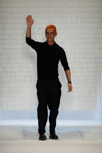 Designer David Delfin on the runway