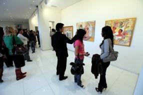 Guests watching paintings during the Akmal Nur Exhibition