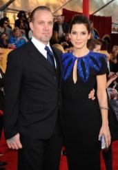 Sandra Bullock (in Alexander McQueen) and Jesse James