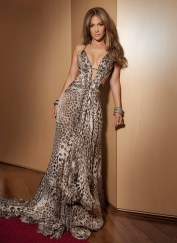 Jennifer Lopez wearing a long, silk mousseline jaguar-printed Roberto Cavalli gown with a small train. It featured Swarovski crystal embroidery and a plunging neckline.