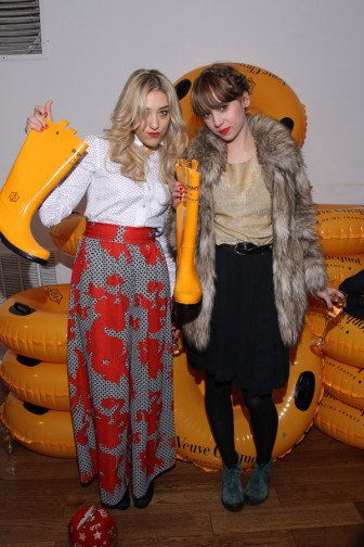Mia Moretti and Caitlin-Moe at the Clicquot in the Snow event showing DKNY for Veuve Clicquot Boots