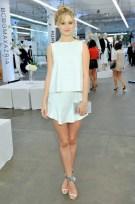 "Ginny Gardner wears BCBGMAXAZRIA ""Vivian Sleeveless Ruffled-Hem Dress"" (IZD66A40); BCBGMAXAZRIA ""Pacer Shoes"""