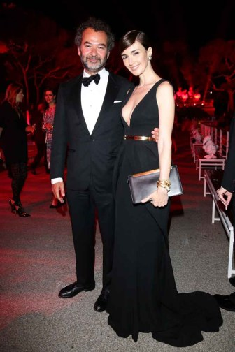 Chairman & Creative Director of The Moncler Group Remo Ruffini and Paz Vega