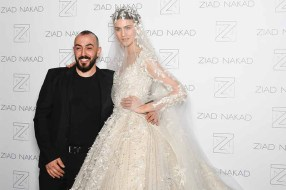 PARIS, FRANCE - JANUARY 24: Designer Ziad Nakad poses with a model backstage after the Ziad Nakad Spring Summer 2018 show as part of Paris Fashion Week on January 24, 2018 in Paris, France. (Photo by Jonathan Philippe Levy/Getty Images For Ziad Nakad) *** Local Caption *** Ziad Nakad
