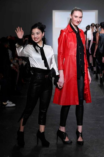 NEW YORK, NY - FEBRUARY 08: Melissa Yin and model walks the runway at Global Fashion Collective Presents Melissa Yin At New York Fashion Week Fall 2018 at Industria Studios on February 8, 2018 in New York City. (Photo by Arun Nevader/Getty Images for Global Fashion Collective)