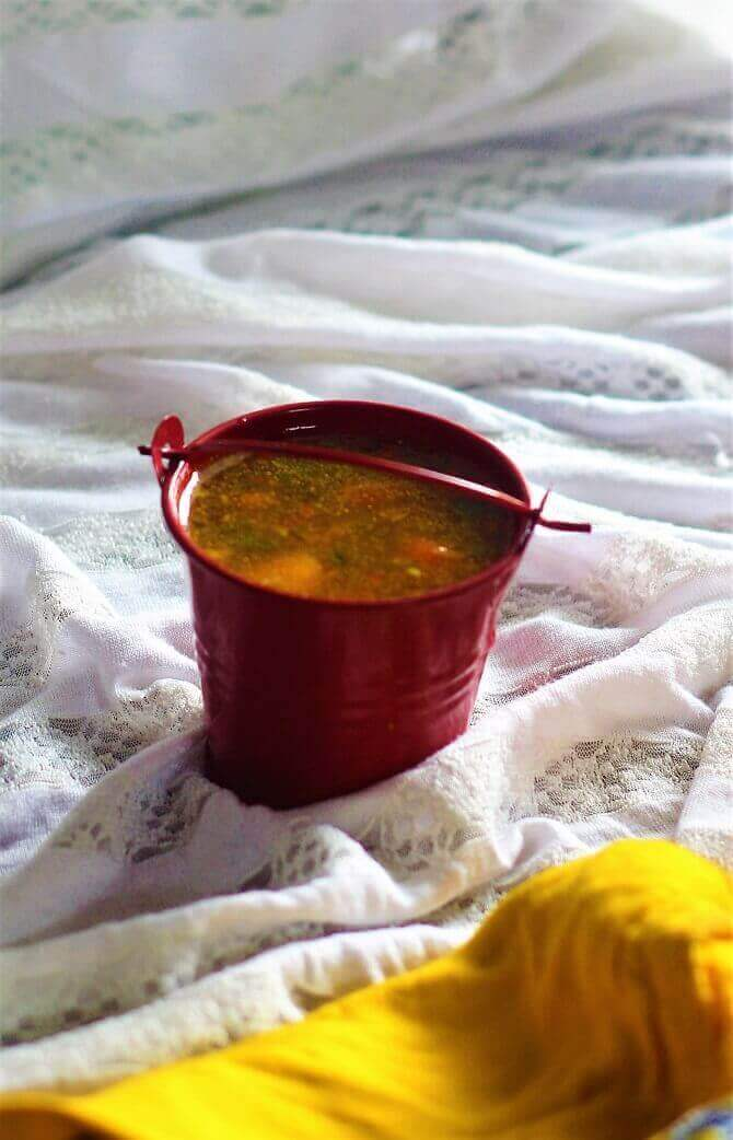 chaaru recipe in a red serving bucket