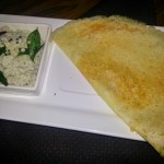 onion dosa recipe served along with coconut chutney on a plate