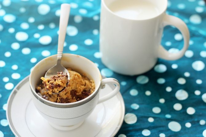 1 minute microwave chocolate chip cookie recipe in a cup with a spoon