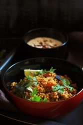 tawa keema recipe served in a red bowl garnished with coriander leaves