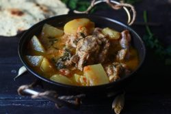 aloo gosht recipe served in a kadai