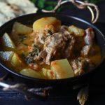 aloo gosht recipe served in a kadai