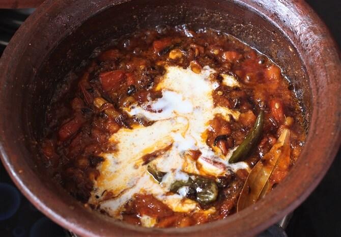 yogurt added to tomato masala for preparing hyderabadi egg biryani