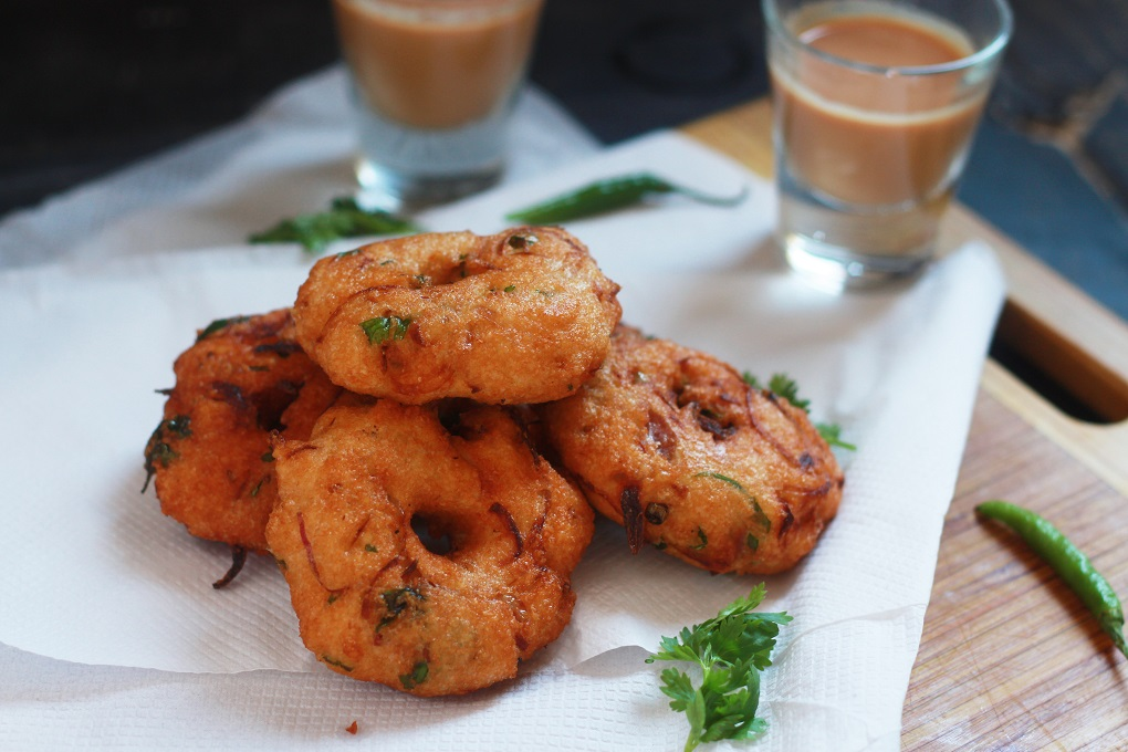 Garelu Recipe is a very popular dish from South India with different names in different regions. It is made of urad dal which is ground and spices are added before frying in hot oil in the shape of a donut.