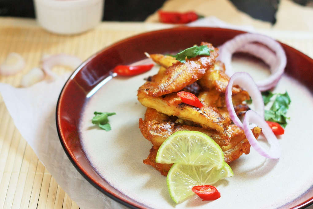 Kerala Fish Fry recipe - Meen Varathathu recipe. A staple dish from the famous state of Kerala, this fish fry is pretty simple to make with the ingredients that you can find right in your kitchen.