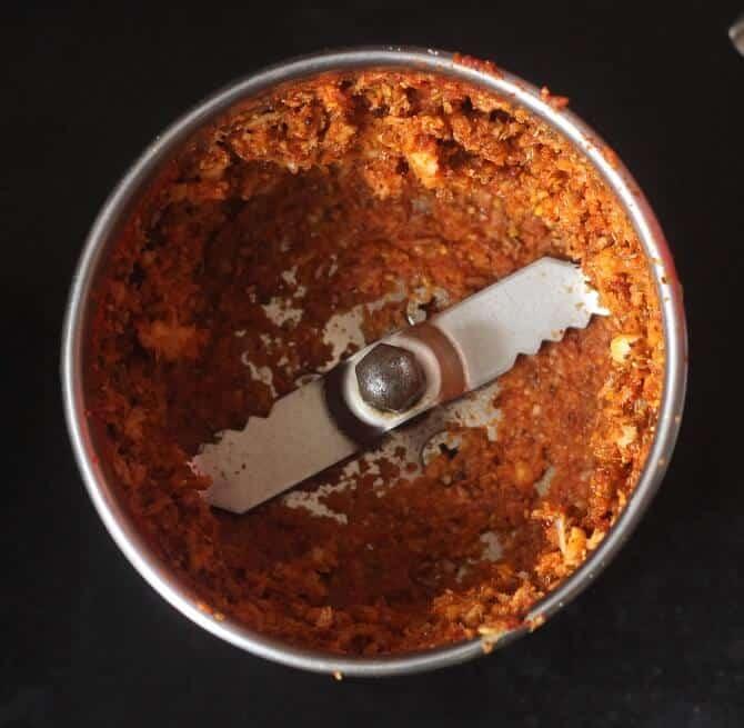 achari gosht masala in a mixie jar