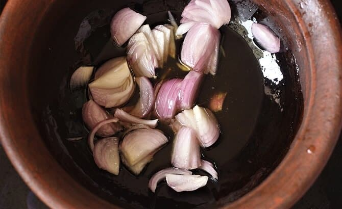 frying onion in a clay pan
