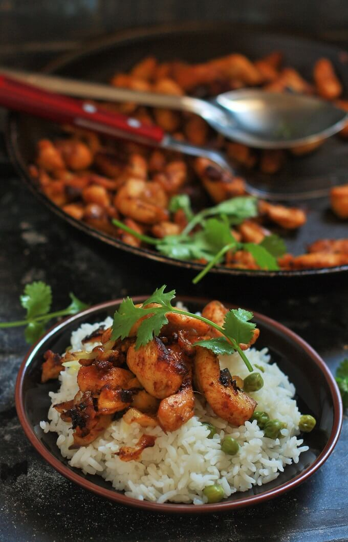side view of tawa chicken fry on rice