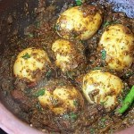 top view of chettinad egg curry in a clay kadai