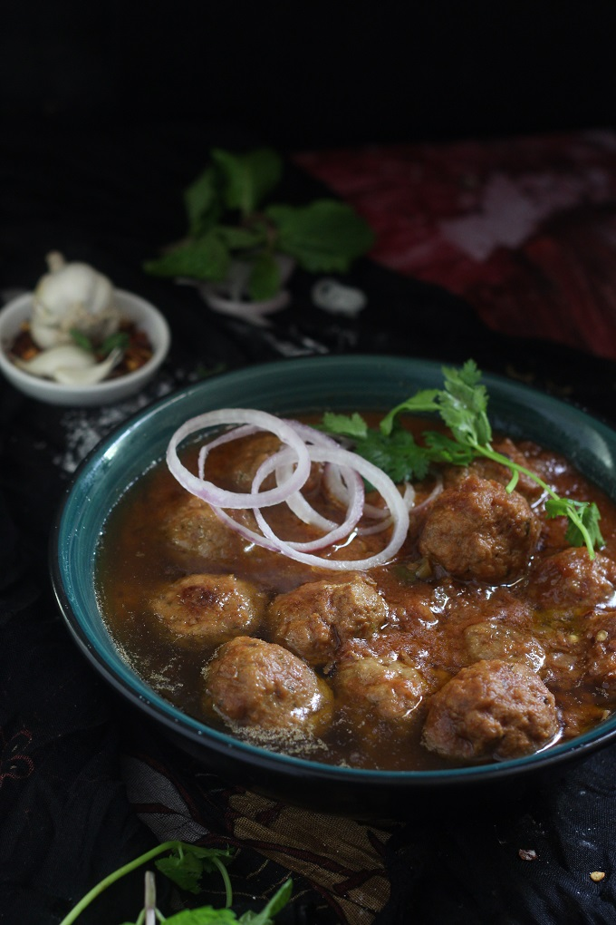 Mutton Kofta Curry or the Indian Meatball Curry recipe, a delicious kofta curry made with mutton mince in succulent onion tomato gravy with aromatic Indian spices. The koftas will be soft on the inside when you follow the simple tip that I have provided in this post