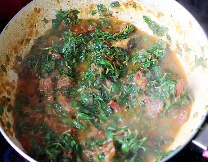 methi leaves added with masala for making the methi gosht recipe