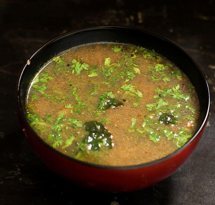milagu rasam recipe, pepper rasam in a bowl