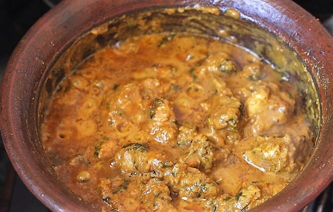 chicken handi getting cooked in a clay pot