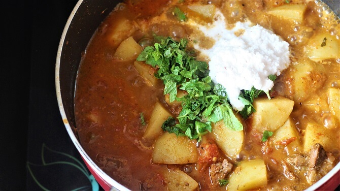 coconut paste, mint, coriander leaves added to the aloo gosht recipe