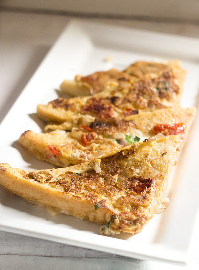 French Toast Indian recipe is a spicy version of the famous toast recipe. Made with Indian spices and ingredients, this toast gets an Indian makeover and tastes awesome.