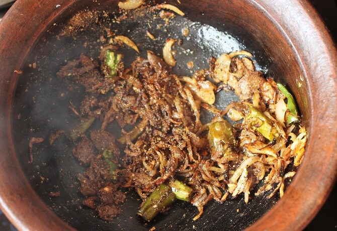 fried onions in a clay pan