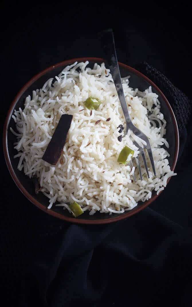 indian cumin rice served in a plate with a fork