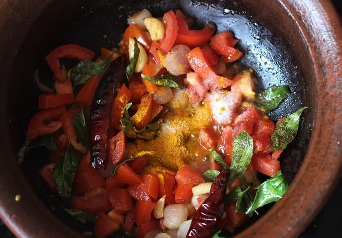 tomato, spices in a clay pot