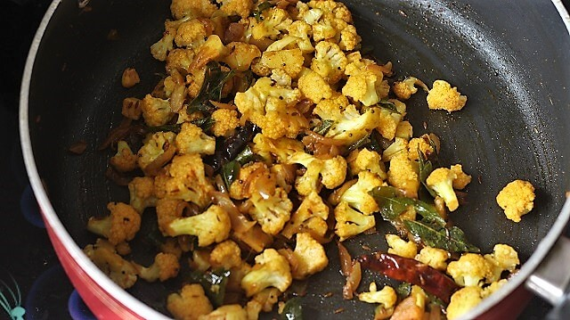 cauliflower poriyal in a black pan
