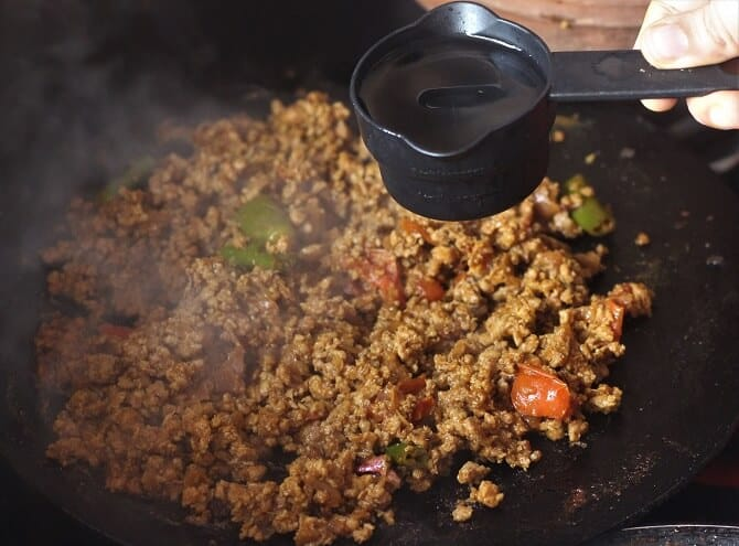adding water to the bhuna keema recipe