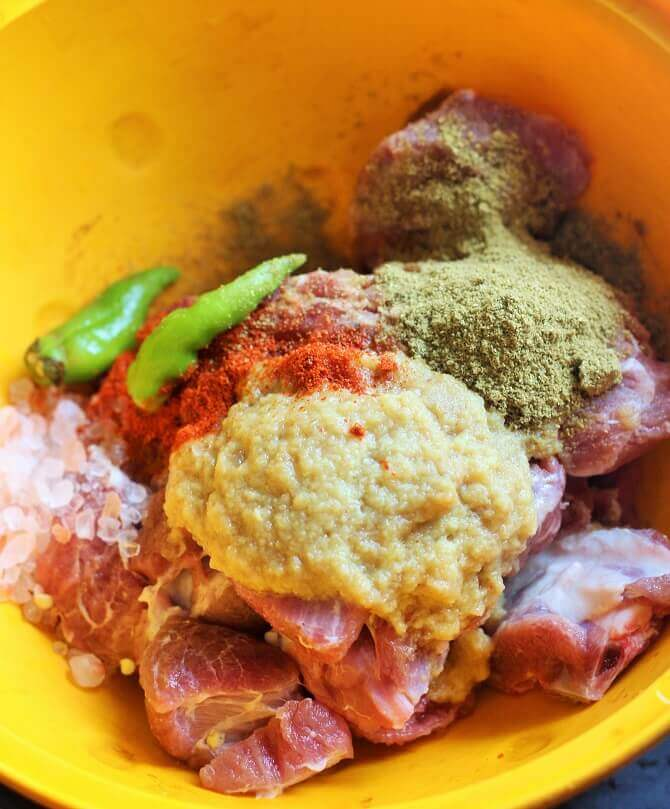 marinating mutton with ginger garlic paste and spices