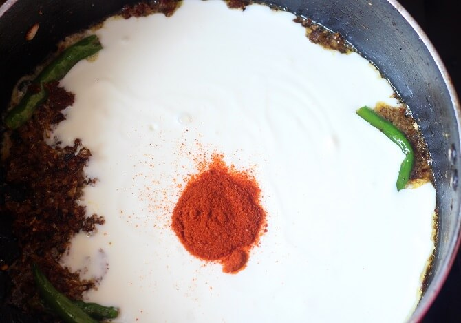 yogurt, red chili powder added to egg dum biryani masala