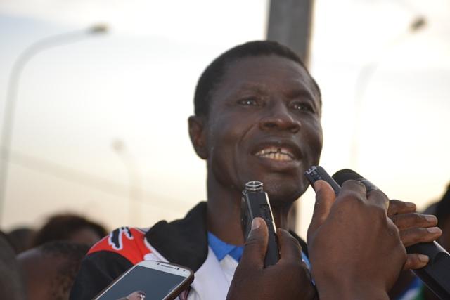 Francis Nacoulma representant le ministre en charge des sports parrain du cross