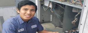 Eduardo working on a commercial HVAC unit