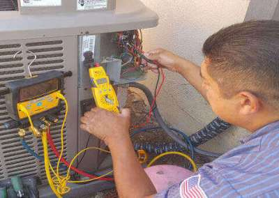 Frank working on Air conditioning system in the city of Whittier