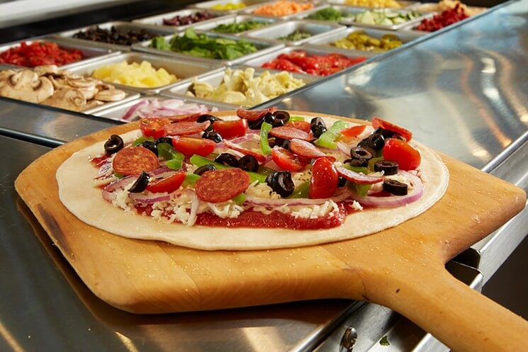 The Race for the Best DIY Pizza is On Pieology vs Blaze