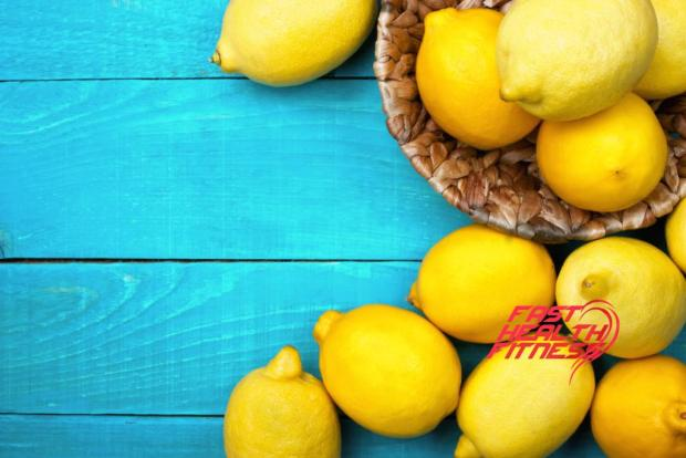 Yellow colorful lemons on the bright cyan wooden table horizontal