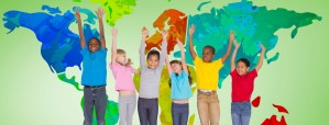 Sic Young children standing in front of a mural depicting a map of the world.